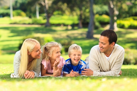 Family lying down in the park Stock Photo - 10184468