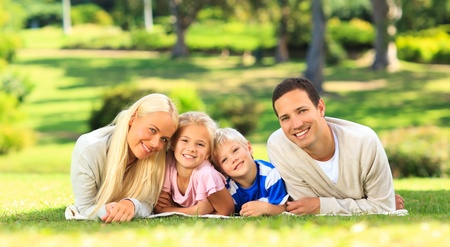 Family lying down in the park Stock Photo - 10184158