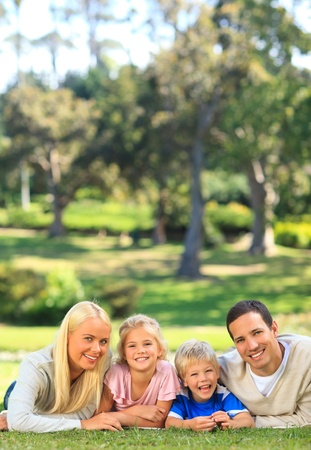 Family lying down in the park Stock Photo - 10184444