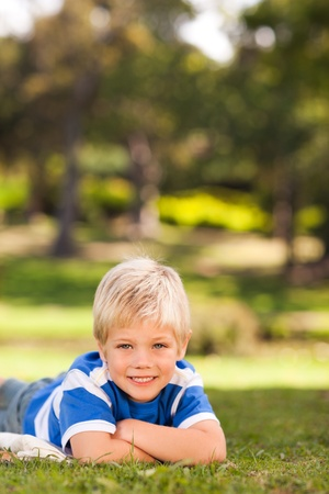 Boy lying down in the park photo