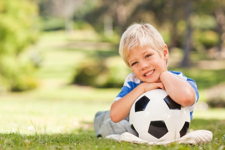 Boy with his ball in the park photo