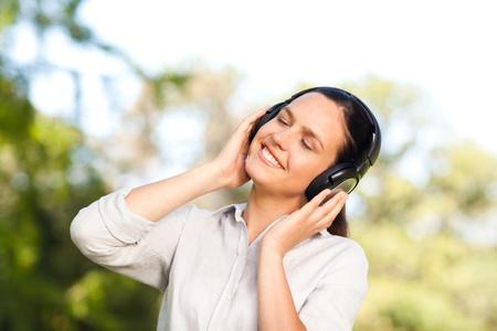 Beautiful woman listening to music photo