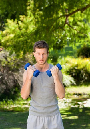 Man doing his exercises in the park Stock Photo - 10184072