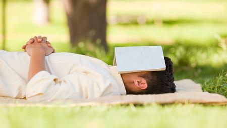 man lying down: Man sleeping with his book Stock Photo