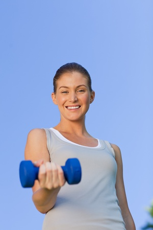 Young woman doing her exercises in the park Stock Photo - 10183776
