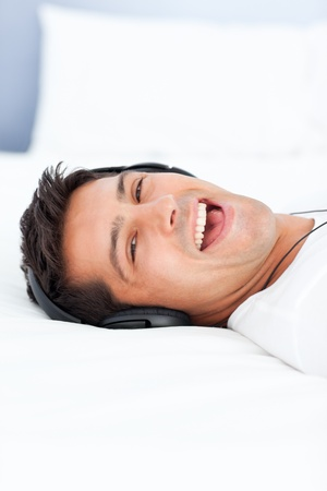 Handsome man laughing while listening music Stock Photo - 10196647