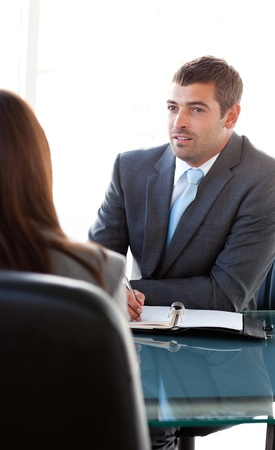 Rear view of a businesswoman talking with a charismatic businessman Stock Photo - 10195322