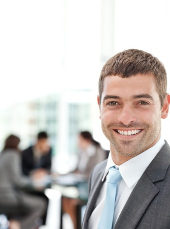 Happy businessman during a meeting with his team photo