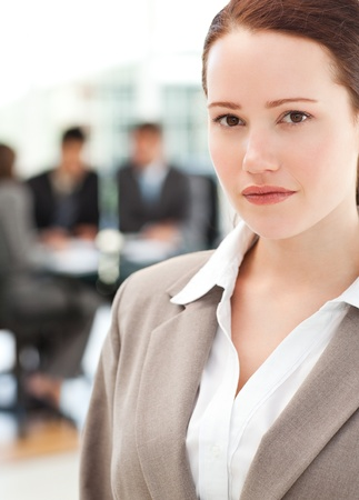 Attractive businesswoman during a meeting with her team  photo