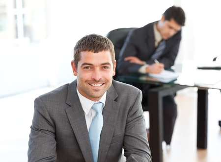 Happy businessman in the foreground during a meeting Stock Photo - 10196931