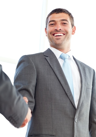 concluding: Below view of a happy businessman concluding a deal with a partner