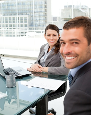 Two positive business people smiling at the camera Stock Photo - 10195315