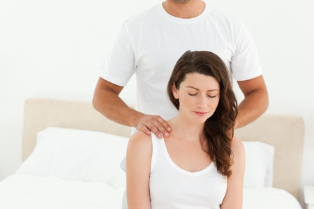 Attentive man doing a back massage to his beautiful wife  photo