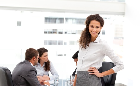 Pretty businesswoman with her team during a meeting photo
