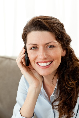 Portrait of a pretty businesswoman talking on the phone photo