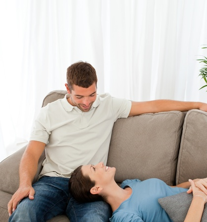 Happy couple relaxing together on the sofa photo