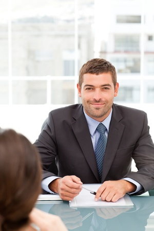 Happy businessman during an interview with a female colleague photo