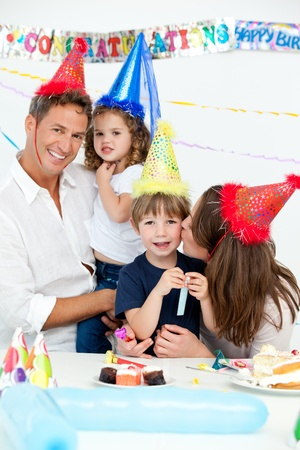 Portrait of a happy family during a birthday party Stock Photo - 10184659