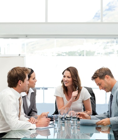 executives: Glad businesswoman talking to her team