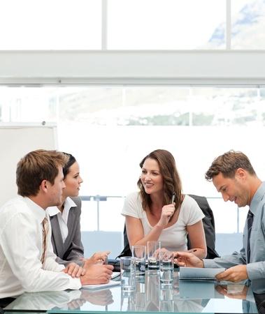 Glad businesswoman talking to her team Stock Photo - 10175928