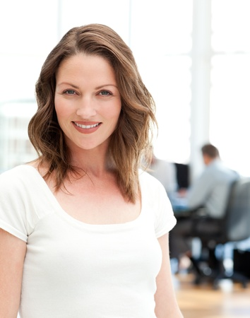 Relaxed businesswoman posing in front of her team  photo