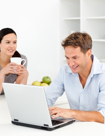 Lovely woman drinking coffee while her husband is working Stock Photo - 10196995