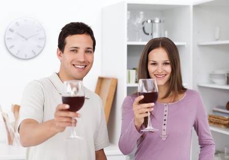 Young couple toasting with glasses of red wine Stock Photo - 10196914