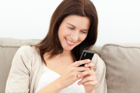 Beautiful woman reading a message on her mobile phone photo