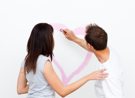 Rear view of a man drawing a heart for his girlfriend photo