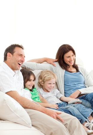 Happy family watching a movie together photo