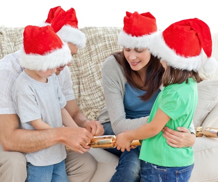 Family opening crackers together on the sofa Stock Photo - 10195705