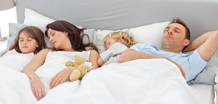 Cute family sleeping together photo