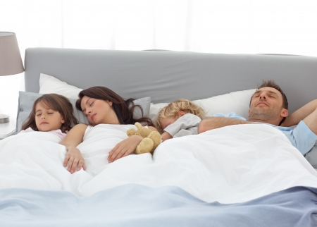 Tranquil children sleeping with their parents Stock Photo - 10196831