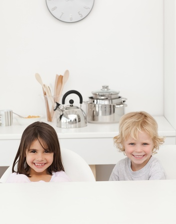 Happy brother and sister waiting their breakfast Stock Photo - 10195230
