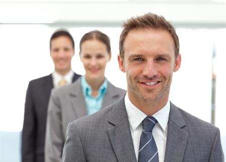 Three happy partners posing in a row photo