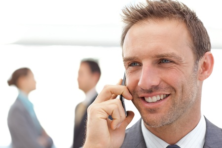 Handsome businessman on the phone photo