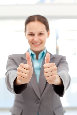 Successful businesswoman doing thumbs up  photo