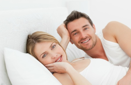 Cute couple lying down together in their bed Stock Photo - 10194023