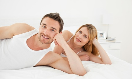 Happy lovers looking at the camera Stock Photo - 10196849