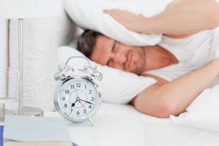 A irritate man in his bed before waking up Stock Photo - 10182652
