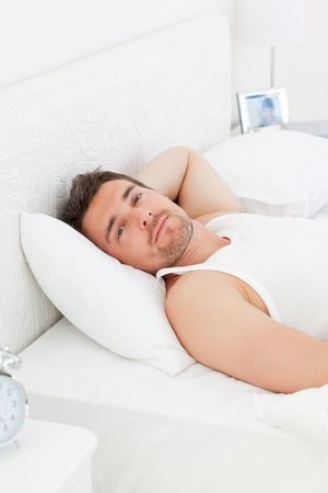 A relaxed man in his bed before waking up Stock Photo - 10196889