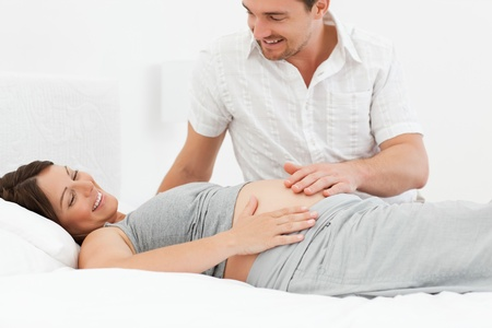 Pregnant woman with her husband Stock Photo - 10197125