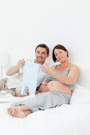 Young futur parents with chlidrens clothes Stock Photo - 10196924