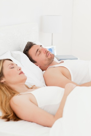 Happy couple in their bed photo