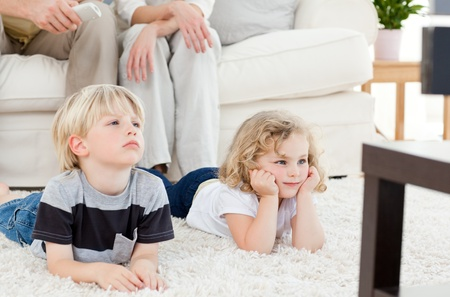 Adorable family watching tv photo