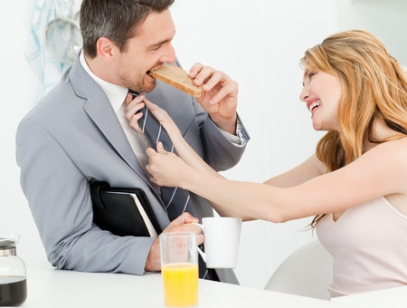 Woman adjusting the tie of her husband photo