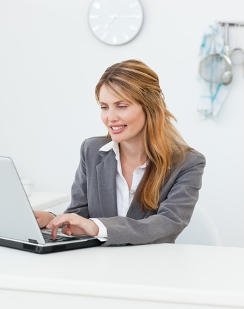 Businesswoman looking at her laptop Stock Photo - 10197063