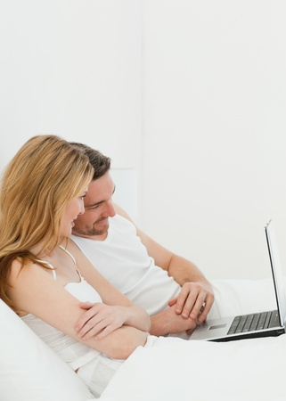 Lovers watching a movie on their laptop photo