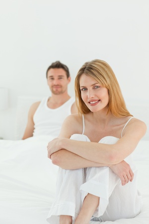 Beautiful woman looking at the camera with her husband Stock Photo - 10196885