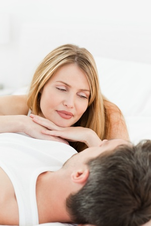 Lovely Couple lying down together in their bed at home Stock Photo - 10197101